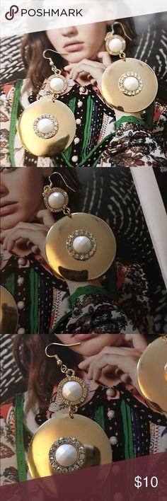 Hot And Spicy Earrings Made like the beautiful vintage jewelry with a modern appeal.  Gold tone earrings with rhinestones and white stones in the middle Boutique Jewelry