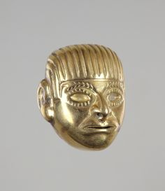 Early Intermediate, Mochica  Bead in the form of a human face, 100 B.C.–A.D. 100  Gold and bone  h. 3.4 cm., w. 2.9 cm., d. 2.8 cm. (1 5/16 x 1 1/8 x 1 1/8 in.)  Place made: North coast, Peru
