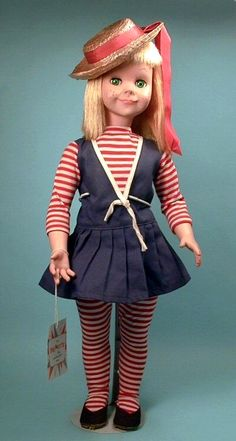 """22"""" vinyl and hard plastic Brikette doll, United States, 1959, by Vogue Doll Co. The mold and concept of Brikette was licensed from the Italian doll maker Bonomi who released a similar (although slightly more exaggerated) doll in the 1950s, and features a ball-jointed waist unusual for American dolls of the period. Although released initially in a bright carrot red haired and green eyed version, in 1960 (rare) brunette and blonde versions were added, as was a more diminutive 16"""" version."""