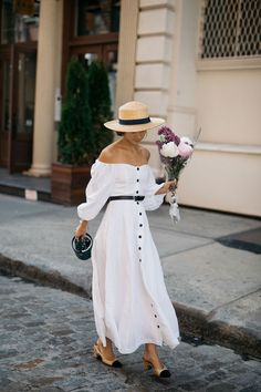 White off the shoulder dress with buttons, chanel heels, bucket bag and straw hat. Summer street style outfit. French girl style. A little white dress for summer.