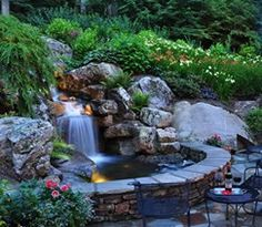 Backyard waterfall design. A waterfall can completely change the atmosphere of your backyard. Falling water produces a peaceful sound that is soothing to the soul. Adding a well-designed waterfall and pond will transform your backyard into a private retreat where you can unwind with friends and family.