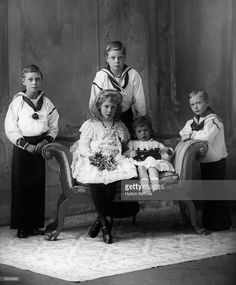 Five of the children of King George V and Queen Mary. From left, King George VI, (1895 - 1952), then Prince Albert, the Duke of Windsor, (1894 - 1972), then Prince Edward, and right, Prince Henry, (1900 - 1974). Seated are Mary, Princess Royal, (1897 - 1965), and Prince George, (1902 - 1942).