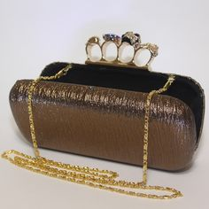 Zella Skull Knuckle Duster Clutch from Trend Station in Shimmering Bronze http://www.trendstation.com.au/collections/knuckle-duster-clutches