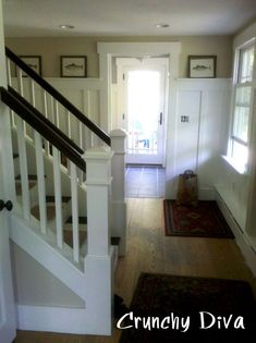 cottage entry hall staircase transformation - view to new mudroom - brown handrail open stair newel post crunchydiva.com