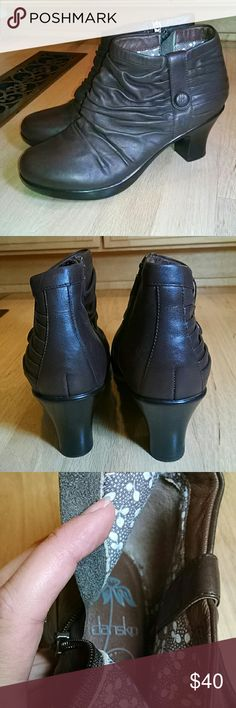 """Brown leather Dansko ankle booties Gathered leather style with self covered button detail. Pretty printed lining. Heel height is 3"""". Synthetic sole. Very little wear on soles, see photo. In great shape. Dansko Shoes Ankle Boots & Booties"""