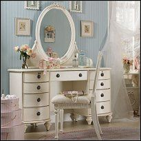 distressed vintage white color finish, antiqued pewter color hardware, embellishments of bows and flowers, sky blue patterned drawer compartments, and crystal cut mirrors all help create the weathered appeal of this Large Vanity with Optional Mirror and Chair.