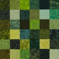 "Greens in emeralds, limes, and sages make up a sparkling quilt.    Bali Crackers (precut 10"" squares), Taffy; @Brett Hoffman Fabrics"