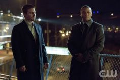 "Arrow -- ""Vertigo"" -- Image AR112a_2144b – Pictured (L-R): Stephen Amell as Oliver Queen and David Ramsey as John Diggle -- Photo: Jack Rowand/The CW -- ©2013 The CW Network. All Rights Reserved"