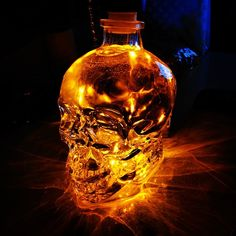 Grab an empty Crystal Head Vodka bottle and add mini led lights for a cool effect. ♡