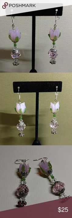 Earrings Long dangling earrings with a pink lamp work glass flower & crystal cut glass beads, rhinestones and Crystals. Antique silver accents. Silver plated fishhook ear wires. Color: Light pink, clear & green. Custom Handmade Jewelry Earrings