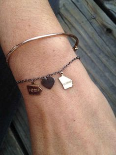 Or this bracelet with your states as the charms, reminding you that it's really not that far away.