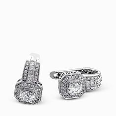 Taking a modern twist on vintage styling, these brilliant white gold earrings are accentuated by .27 ctw round cut white diamonds and highlighted with .21 ctw princess cut diamonds.