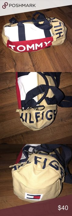 Vintage Tommy Hilfiger Spell Out Canvas Duffle Bag Small mark on the top. Measures 17 inches across and 8 inches tall Tommy Hilfiger Bags Duffel Bags