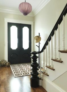 LOVE the black doors and in particular, the black banister/newel post. Black Stair Railing, Stair Banister, Black Stairs, Banisters, Wood Railing, Black Painted Stairs, White Banister, Banister Ideas, Modern Railing