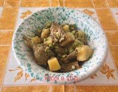 Carciofi con patate e piselli