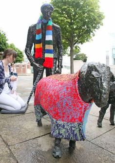 Yarn bombing at the sheep sculpture outside Belfast's Waterfront Hall