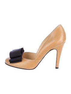 Tan Kate Spade leather pumps with black grosgrain bow appliques and covered heels.