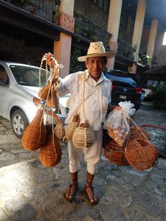 Charming man selling his hand made gourd water containers in Cuetzalan, Puebla.