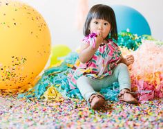 Giant balloons + piles of confetti make for bright, fun, simple birthday party decorations. Image from Oh Joy! #allaboutballoons #decor #celebrate