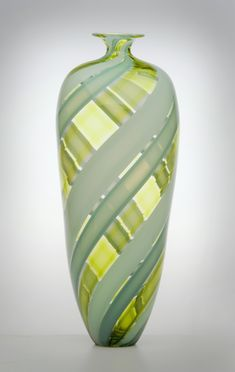 "Unusual pattern - ""Tessera Bottle"" Created by Nicholas Kekic - tall blown glass bottle with canework. For some reason I think of Scotland when I look at this...."