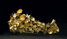 "NASUUT TIARA.   This tiara is a gift to Queen Margrethe II of Denmark from Greenland to celebrate her 40th Jubilee. Nasuut is translated to ""flower"" in Greenlandic.    The tiara is made of gold and has small diamonds --- the gold comes from Greenland's recycled coins."