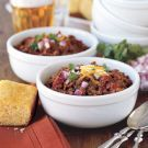 """Try the 6-Hour Chili Recipe on Williams-Sonoma.com.  This weekend looks like it is going to be cloudy and chilly, so this is my """"go to"""" chili recipe.  Excellent!  Tweak it to your personal taste.  I don't usually do mine in a slow cooker, but cook it slowly on top of the stove instead.  I serve mine with cornbread muffins!!!  You've got to do the cilantro, cheese, & sour cream.  So good!"""