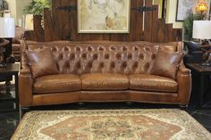Treat your living room to this high quality tufted full-grain leather sofa!  After years of use, this piece won't wear out, but will instead develop a patina over time, adding to the sofa's charm and overall character!  Get yours TODAY and start living in style! | Houston TX | Gallery Furniture |