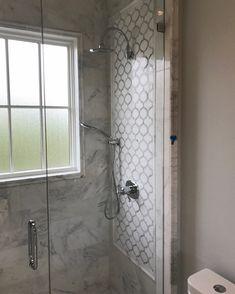 "Carrara marble Shower wall tile. Marrakech arabesque waterjet mosaic white Thassos + Carrara marble. 1""x12"" Pencil trim used to border the accent tile (arabesque)."