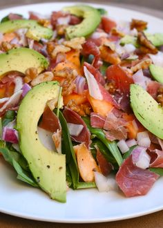 Prosciutto, Melon, and Spinach Salad Makes 2 large salads 2 cups baby spinach 1/3 pound prosciutto 1 canteloupe 1 avocado 1/4 cup diced red onion handful of raw, unsalted walnuts