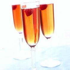 Cran-Raspberry Spritzer - 1 cup cranberry juice, chilled $  1/4 cup raspberry vodka, chilled  3 cups sparkling wine, chilled  Garnish: fresh raspberries