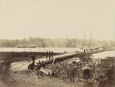 Strips of water a few hundred feet wide often nullify the plans for entire armies. In this photograph is one of the pontoon-bridges across the James, at Powhatan Point, near Harrison's Landing, which was used by part of General Grant's army in the march from Cold Harbor to Petersburg. THE PHOTOGRAPHIC HISTORY OF THE CIVIL WAR IN TEN VOLUMES