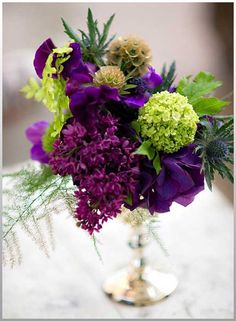 purple-and-green-wedding-flower-arrangements http://oncewedd.com/the-combination-of-purple-and-green-wedding-flowers/purple-and-green-wedding-flower-arrangements/