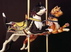 Cats aboard the Golden Gate Park Carousel. Restoration by Bay Area artist Ruby Newman.:
