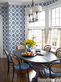 Breakfast Room ~ Tom Scheerer - Tiles mimic wallpaper in the breakfast room, where a vintage French light fixture hangs above Thonet bent-wood chairs.