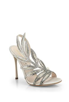 Brides.com: 31 Sparkly Wedding Shoes                          If there's one thing most brides can agree on, it's that there's no such things as too much sparkle on your wedding day. One of the most stylish ways to add a healthy dose of bling to your bridal look? By walking down the aisle in a pair of sparkly shoes, of course.   Your wedding shoes are inherently very personal, especially since most of the time, unless you're rocking a little white dress, they're essentially hidden under your…