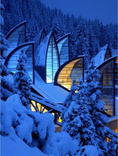 Wellness Center Tschuggen Berg Oase (Arosa, Switzerland) by architect Mario Botta (b 1943), Botta's approach is to create a context marked by the contrast of natural elements. Arosa is like a natural bowl surrounded by mountains, a place where the comparison between man & nature is pronounced & the ancestral fight between man & mountain is ongoing. The idea was to create structures that appear to emerge from the landscape, like artificial trees, as a metaphor of nature. Photo © Urs Homberger