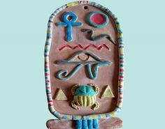 Students design an ancient Egyptian cartouche using air dry clay and add colour with watercolour paint. Egyptian Crafts, Ancient Egyptian Art, Ancient History, Art History, Ancient Egypt Display, 6th Grade Art, Fourth Grade, Clay Art Projects, Egypt Art