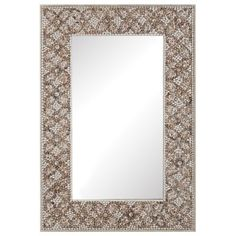 """This wall mirror delivers intricately-designed beach inspiration to the walls of bedrooms, living rooms, and hallways. On a metal frame, various shades and shapes of shells in a mosaic-style cross-hatch pattern offer dimensional allure to this reflective accent. 24""""W x 2""""D x 36""""H. Weight: 24 lbs.. Metal hanging brackets included. Wipe down with soft, dry cloth and glass cleaner to clean."""