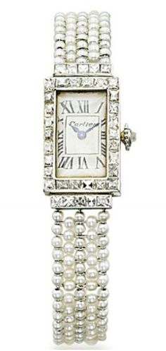 A LADY'S ART DECO DIAMOND AND PEARL WRISTWATCH, BY CARTIER.   The rectangular cream dial bearing Roman numerals and baton hands, within a french-cut diamond frame, to the seed pearl mesh bracelet and deployant buckle, 1920s, 15.0 cm, in red leather Cartier case  Dial signed Cartier