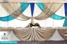 Ivory, champagne sequin, turquoise & royal blue Wedding Decor | Mt. Brydges ON | LUXE Weddings and Events