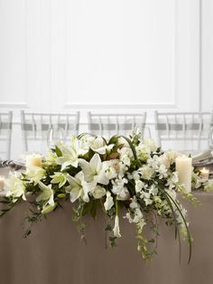 SWEETHEART TABLE:  Make in two parts.  Bride's Bouquet goes between, draping over edge of table.  Include pink roses.  Substitute hydrangeas for the Oriental Lilies. Less greenery.  Use Dusty Miller instead.