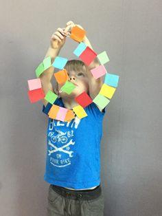 A Spiral Cut and Stick. Matisse Snail. Colour. Preschool art. Early years Art education.