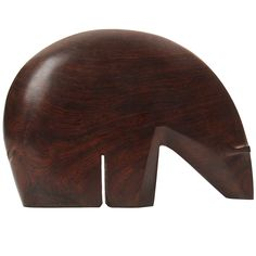 A finely carved, simple abstract sculpture in the form of a polar bear in solid Brazilian rosewood. | From a unique collection of antique and modern sculptures at http://www.1stdibs.com/furniture/more-furniture-collectibles/sculptures/