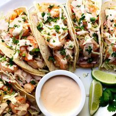 Easy, healthy and, most importantly FABULOUS Shrimp Tacos!! With cabbage and radish slaw for crunch and creamy, spicy Shrimp Taco Sauce! #shrimptacos #easyshrimptacos #shrimptacoswithcabbageslaw