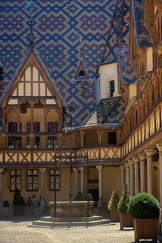 Beaune, Burgundy - France  These magnificent patterned roofs are all over Europe.