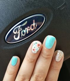 Summer nail design with accent nails - Teal, silver glitter and coral flowers