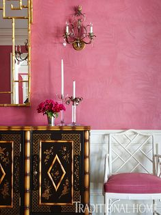<Pink Dining Room Details>Why it makes us swoon:Pretty patterns draw us in. Look closely, and you can see the subtle beauty of palm leaves adorning the pink walls. Bamboo trims an intricately decorated chinoiserie credenza and white-painted Chippendale-style chairs upholstered in pink-and-red checks