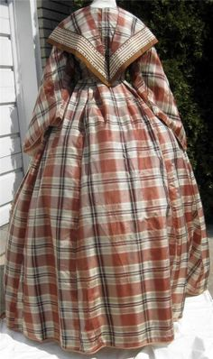 "1860s Brown Plaid Silk Dress Partial 2nd Bodice Pelerine or Fichu Pagoda Sleeves | eBay seller mrandmrsciv; fichu trim of 3.25"" ribbons; front hook & eye closure; boned in two darts on either side, brown cotton lining, sleeves lined w/ white cotton, faced w/ pale pink silk; evening bodice - back hook & eye closure, white cotton lining, boned; box-pleated skirt, tight gauging in back, white cotton lining, tan wool hem binding; bust: 35""; waist: 24"" skirt length: 44-48""; hem width: 255.5"""