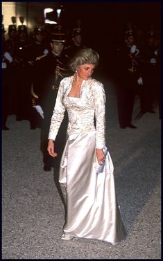 Designed by Victor Edelstein, this cream-colored silk dress was seen during the princess's official visit to the Élysée Palace in Paris in 1988.