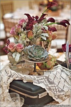 i love the blue and sage succulents with berry flowers - maybe ranunculus, peony, callas, etc.